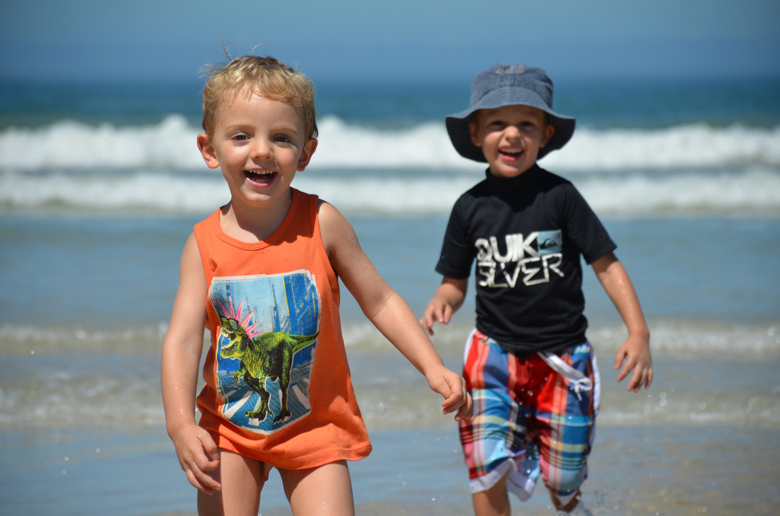 Lincoln and Owen so happy on the beach.
